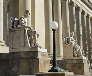 Limestone figures at the entrance to the Memphis Courthouse - Authority and Liberty